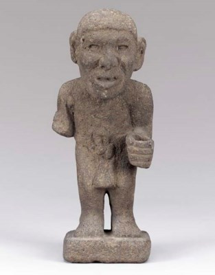 AN AZTEC CARVED LAVA FIGURE,
