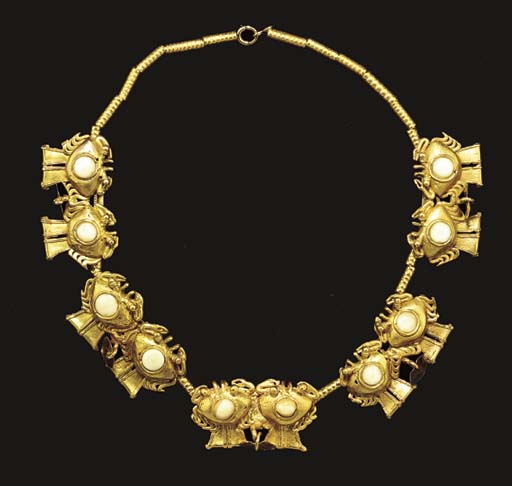 A COCLE GOLD NECKLACE**,