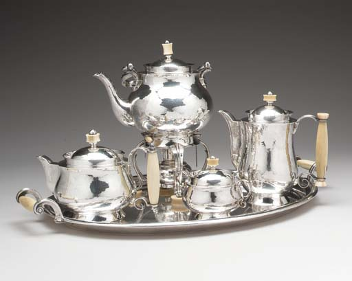 A FOUR PIECE GERMAN SILVER TEA