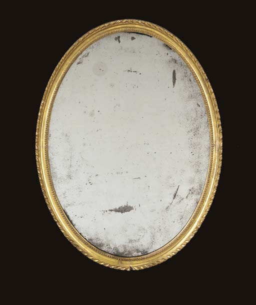 A GEORGE III GILTWOOD MIRROR,