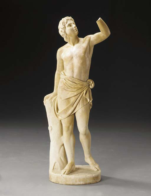A BEIGE MARBLE FIGURE OF A YOU