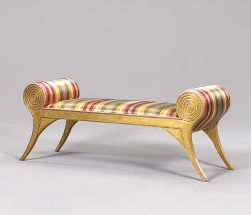 AN UPHOLSTERED GILT-WOOD BENCH