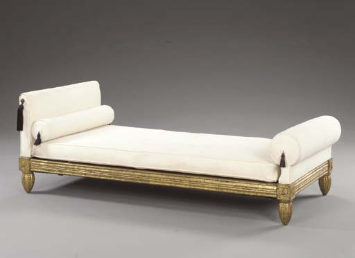 A CARVED GILT-WOOD DAYBED