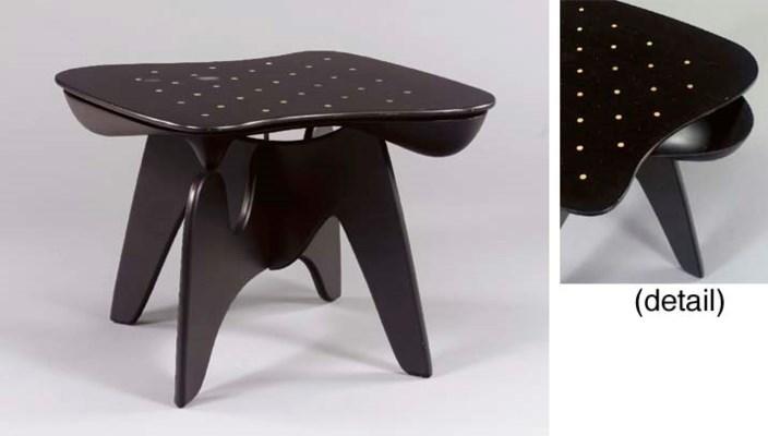 AN EBONIZED PLYWOOD CHESS TABL