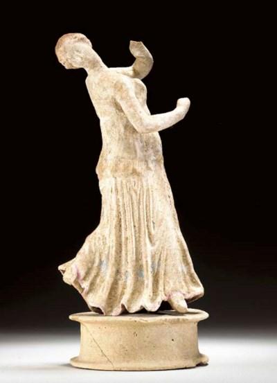 A GREEK TERRACOTTA DANCING WOM