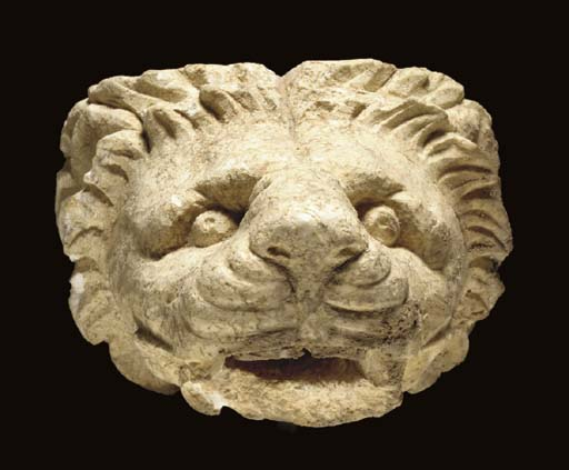 A GREEK LIMESTONE LION-HEAD WA