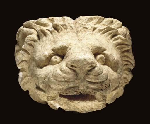 A GREEK LIMESTONE LION-HEAD WATER SPOUT