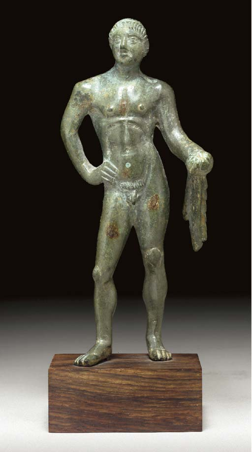 AN ETRUSCAN BRONZE FIGURE OF H