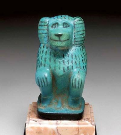 AN EGYPTIAN FAIENCE BABOON
