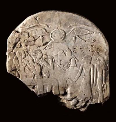 AN EGYPTIAN LIMESTONE FRAGMENT