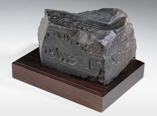 AN EGYPTIAN GRANITE FRAGMENT