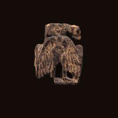 AN EGYPTIAN BONE AMULET