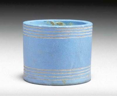 AN EGYPTIAN BLUE CYLINDRICAL V