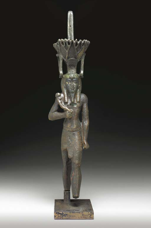 AN EGYPTIAN BRONZE FIGURE OF N