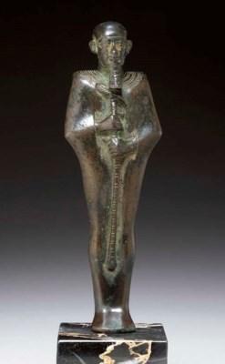AN EGYPTIAN BRONZE FIGURE OF P