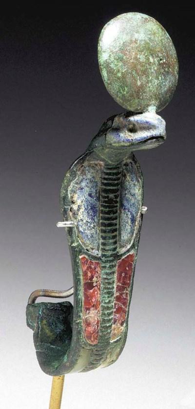 AN EGYPTIAN BRONZE URAEUS