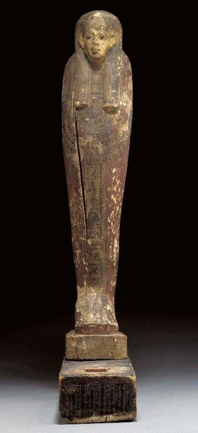 AN EGYPTIAN PAINTED WOOD FIGUR