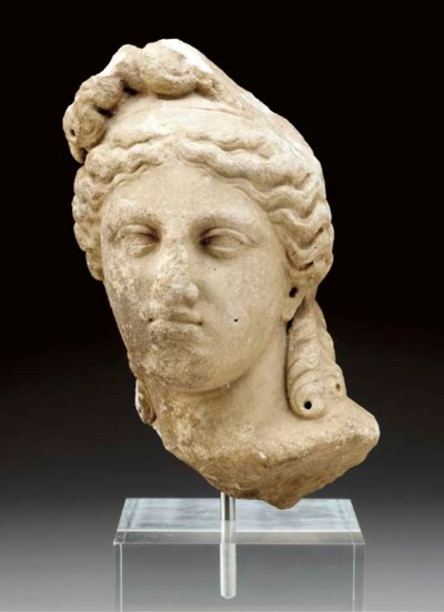 A ROMAN MARBLE HEAD OF A DEITY