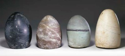 FOUR BACTRIAN STONE WEIGHTS