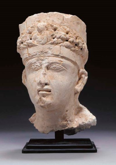 A PALMYRENE LIMESTONE HEAD OF