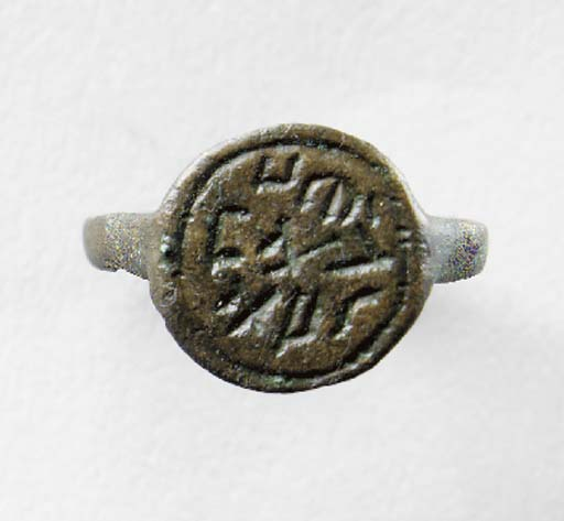 A SAMARITAN BRONZE RING