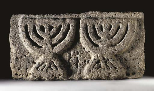 AN EARLY JEWISH BASALT MENORAH