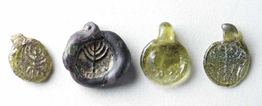 FOUR LATE ROMAN STAMPED GLASS