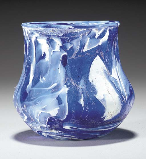 A ROMAN MARBLED GLASS CUP