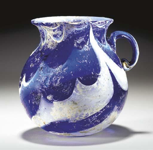 A ROMAN MARBLED GLASS JAR
