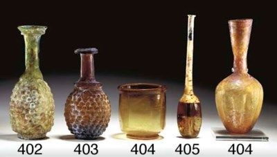 A ROMAN GLASS UNGUENTARIUM