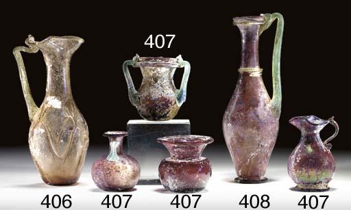 A LATE ROMAN GLASS OINOCHOE