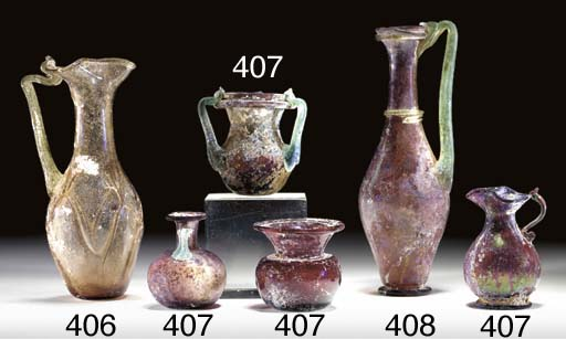 FOUR SMALL ROMAN GLASS VESSELS