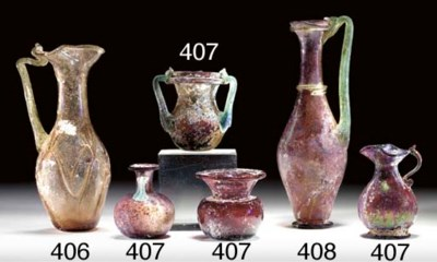 FOUR SMALL ROMAN GLASS VESSELS