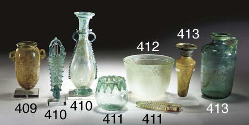 A ROMAN GLASS SQUAT AMPHORISKO