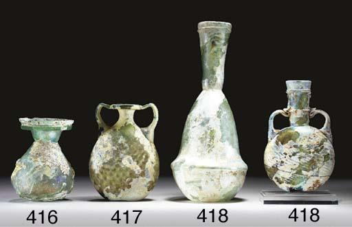A ROMAN GLASS SPRINKLER FLASK