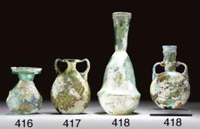 A LATE ROMAN GLASS FLASK