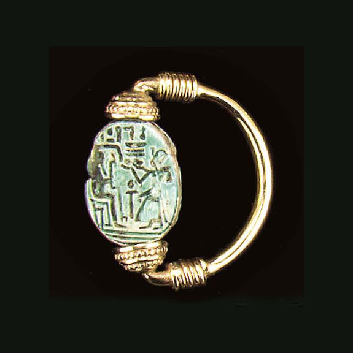 AN EGYPTIAN FAIENCE SCARAB