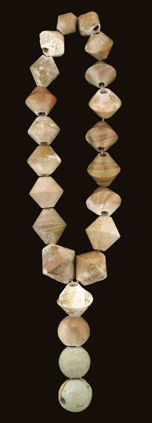 A GROUP OF SUMERIAN STONE BEAD