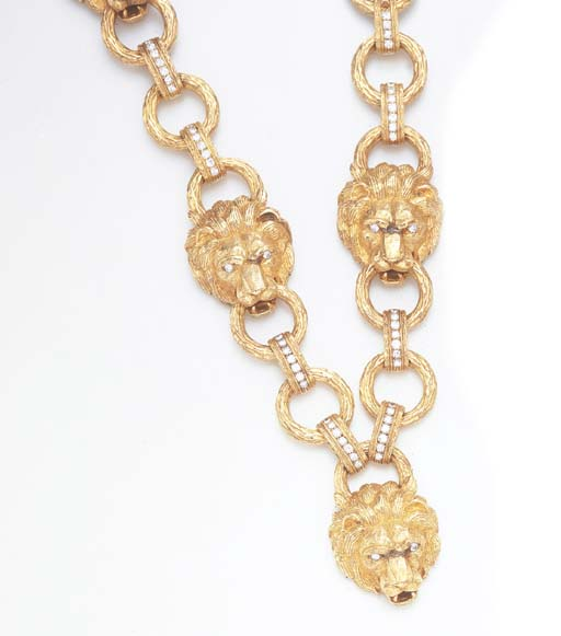 A DIAMOND AND GOLD LION HEAD S