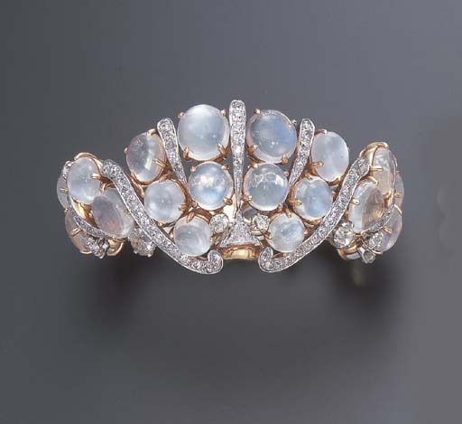 A MOONSTONE AND DIAMOND BRACEL