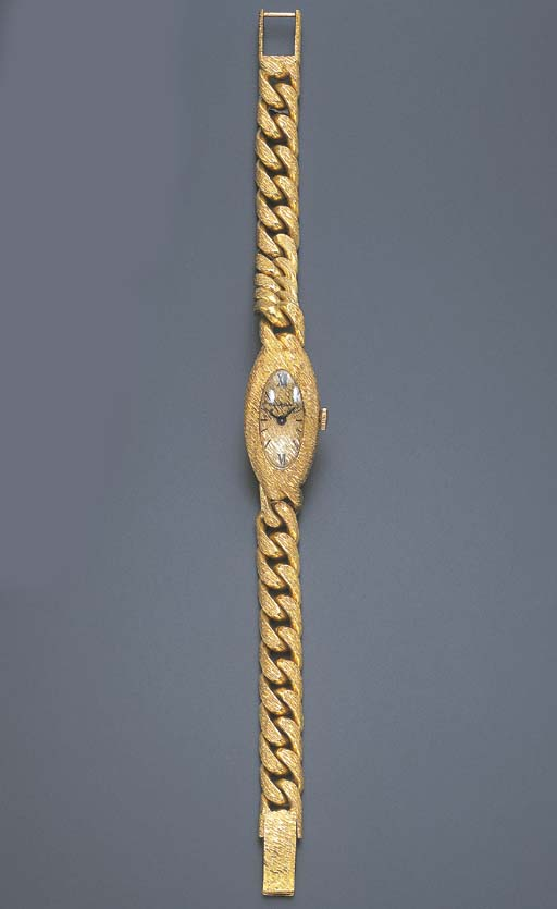 A GOLD WRISTWATCH, BY BUECHE-G