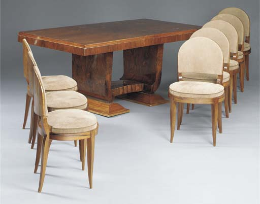 A ROSEWOOD DINING TABLE AND EI