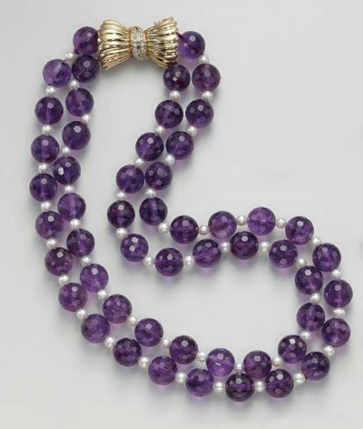 A DOUBLE-STRAND AMETHYST BEAD