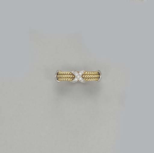 A GOLD AND DIAMOND RING, BY JE