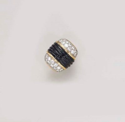 AN ONYX AND DIAMOND RING