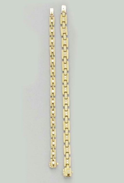 A PAIR OF GOLD AND DIAMOND BRA