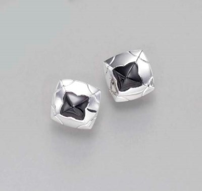 A PAIR OF ONYX AND WHITE GOLD