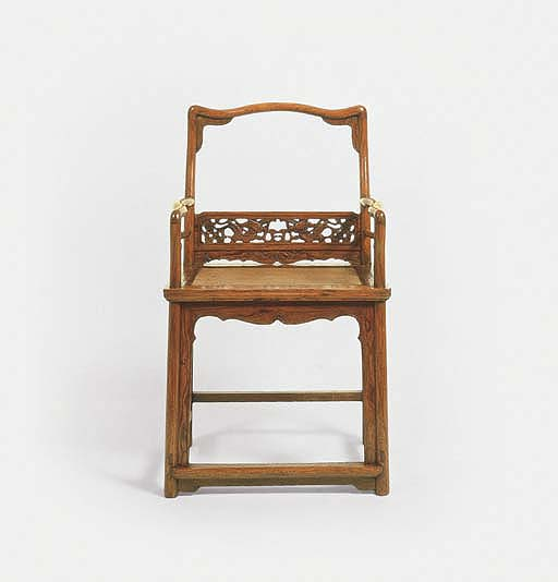 A HUANGHUALI LOW-BACK ARMCHAIR