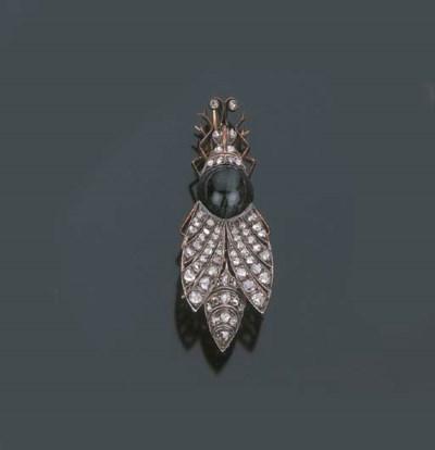 Antica spilla in diamanti e oc