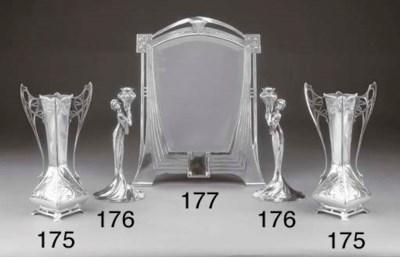 Coppia di candelieri in silver
